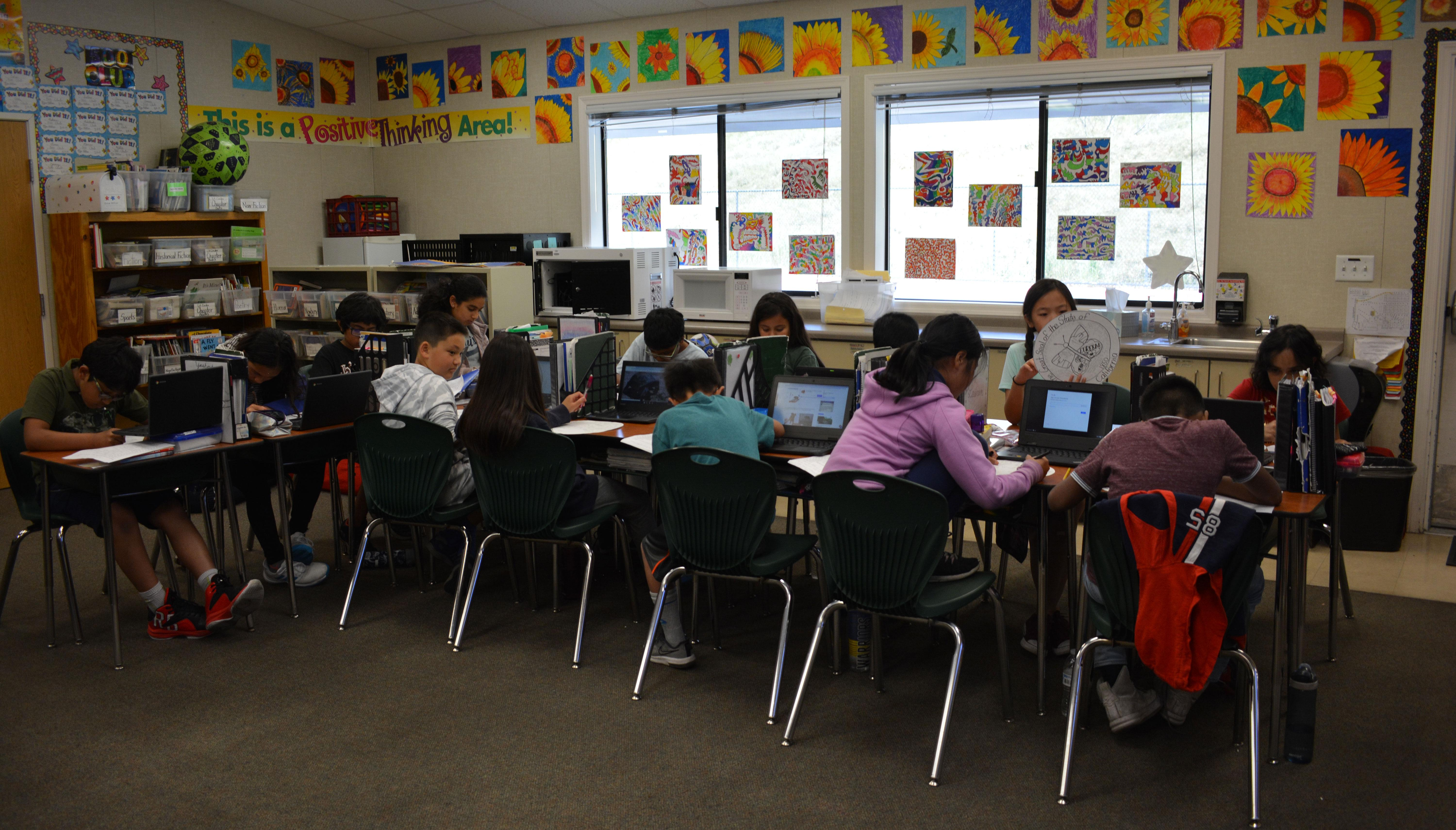 Students using Chrome Books