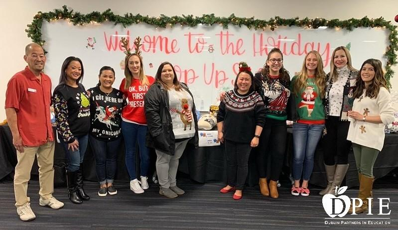 Extended Day Care Staff helping to wrap presents